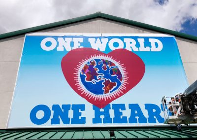 Large One World One Heart Building Banner Installation
